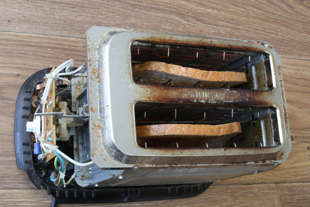 Old toaster insides with burnt toast